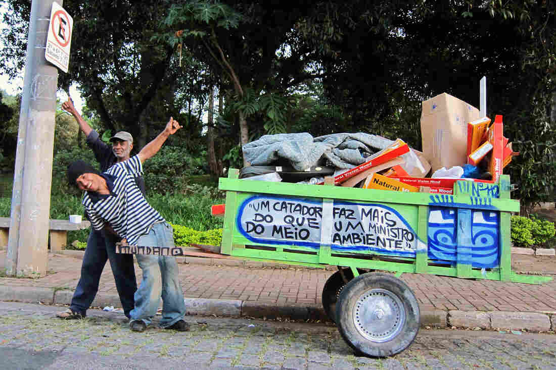 """Trash pickers collect 90 percent of waste that gets recycled in Brazil yet local governments give them little support. The message on this cart: """"One catadore does more than an environmental minister."""""""