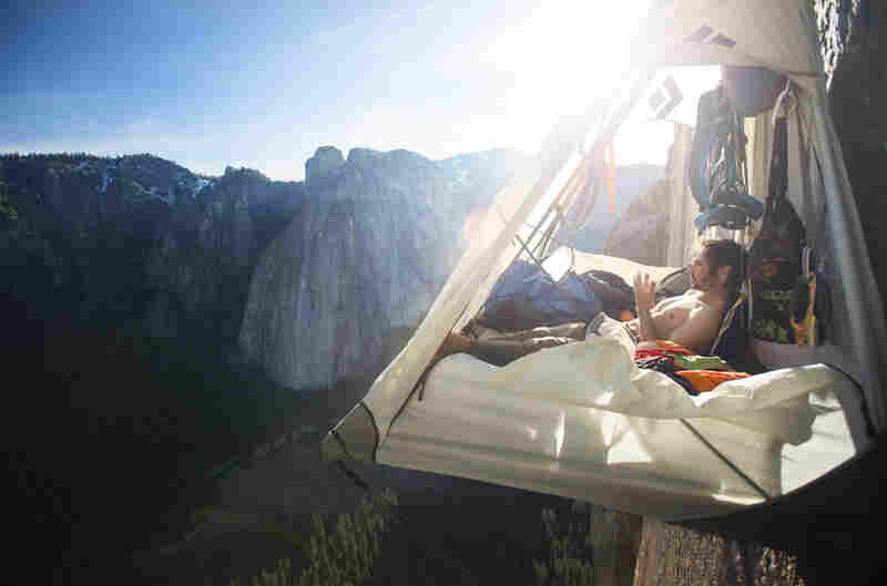 Jorgeson examines his worn fingers as he rests in his portaledge on El Capitan's Dawn Wall.
