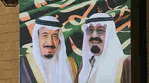 King Abdullah (right) and Crown Prince Salman (left) are shown in this 2012 poster. The king, who is at least 90, was hospitalized last week and Salman on Tuesday stepped in for the monarch and delivered an annual televised speech to the nation.
