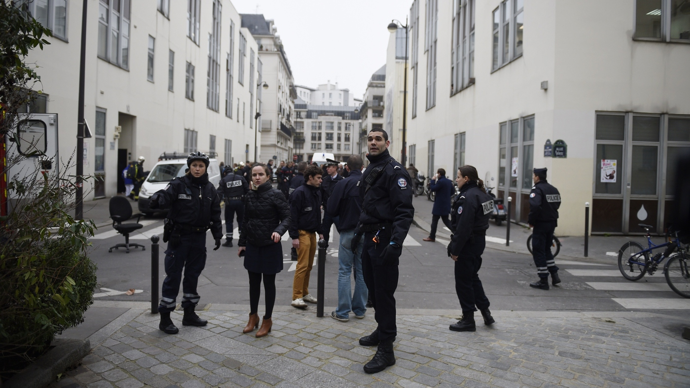 At least 12 die in shooting at magazines paris office; suspects
