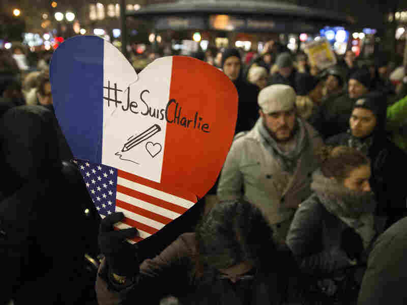 Mourners attend a rally Wednesday night at Union Square in New York City in support of Charlie Hebdo, a French satirical weekly newspaper that fell victim to a deadly terrorist attack earlier in the day.