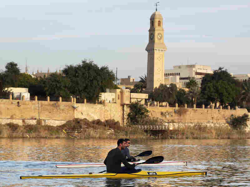Young members of the Baghdad Rowing Club practice on the river Tigris, close to the University of Mustansiriyah in the Iraqi capital