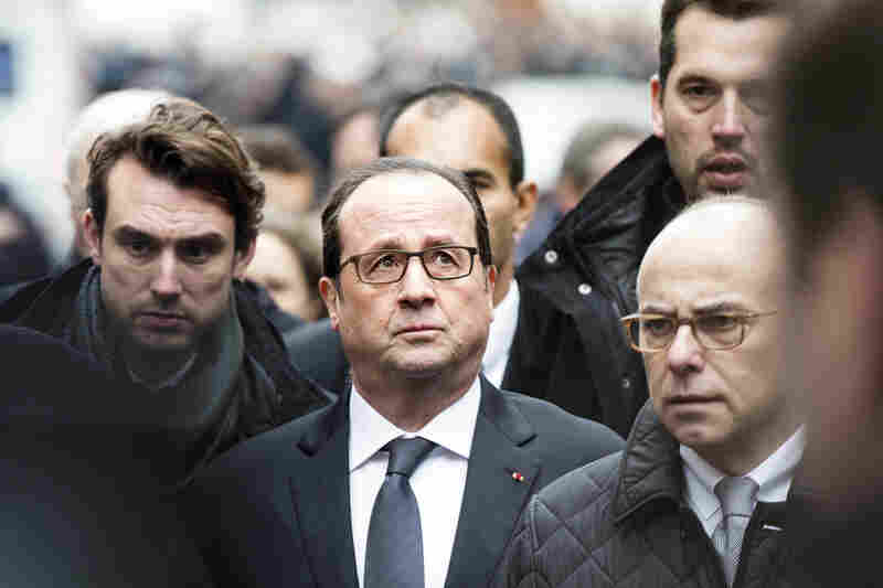 """France today faced a shock,"" Hollande (center) said, according to a BBC interpreter. ""Today, I'm thinking about the victims."""