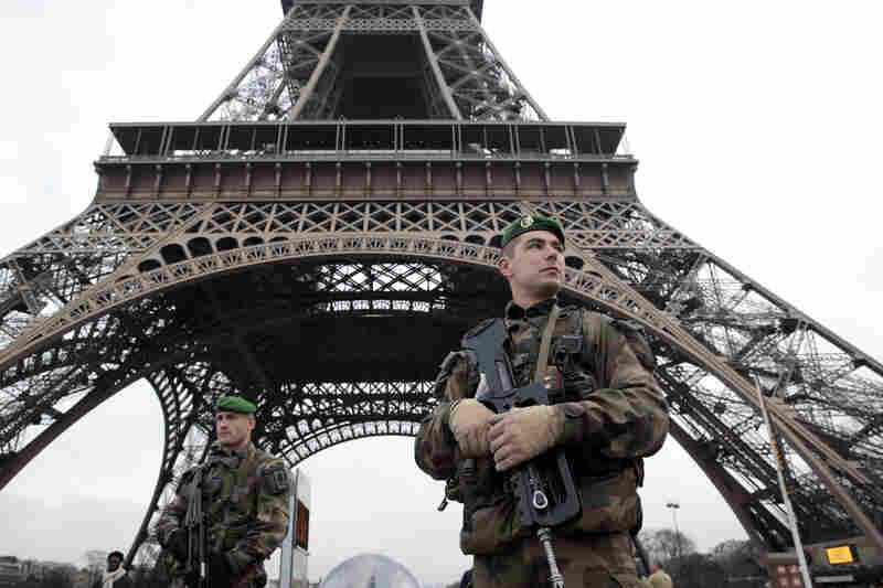French soldiers patrol in front of the Eiffel Tower. The capital was placed under the highest alert status following the attack.