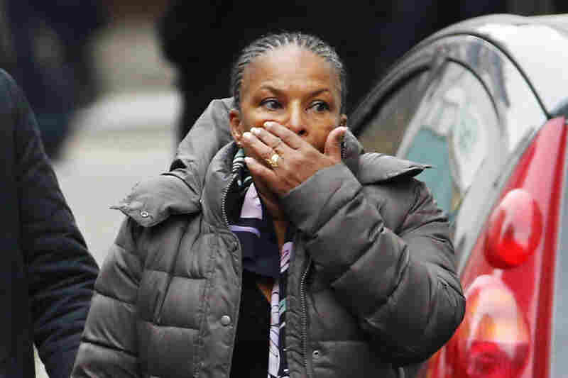 French Justice Minister Christiane Taubira reacts to the scene after the attack.