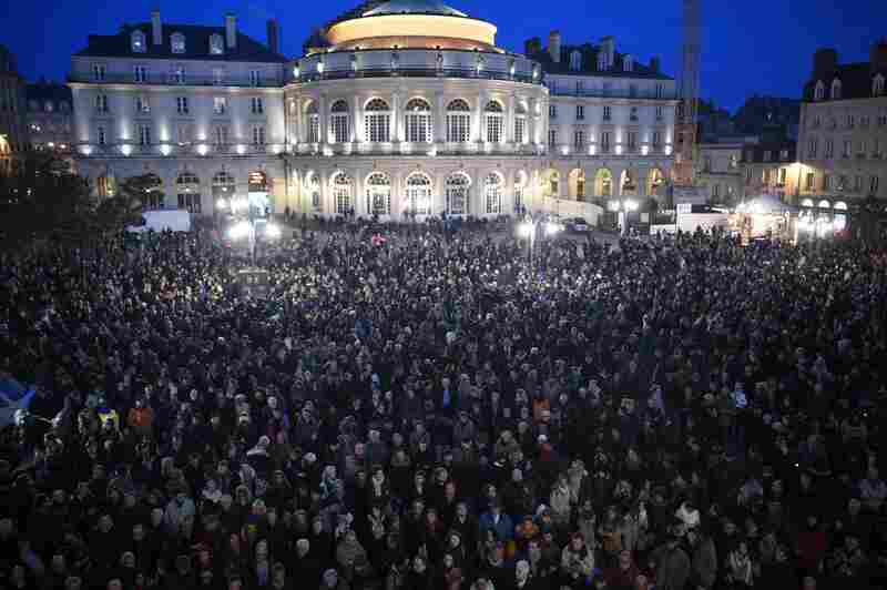 People gather in front of City Hall in Rennes, western France, in a show of respect for those slain Wednesday in an attack on the headquarters of the French satirical magazine Charlie Hebdo. At least 12 people were killed, according to police.