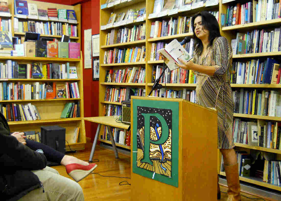 Michele Serros reads from Chicana Falsa during a 2012 event at Pegasus Books in Berkeley, Calif.