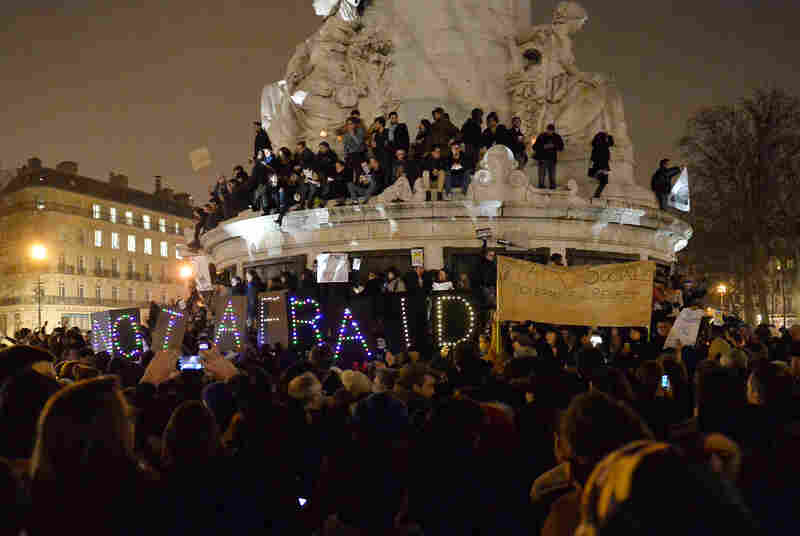 An estimated 5,000 people gather at the Place de la Republique to show solidarity after a terrorist attack Wednesday in Paris. Twelve people were killed, including two police officers; police are still looking for the two gunmen.
