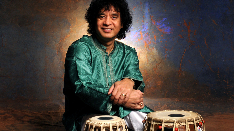 Zakir Hussain learned from the best — his father, Allah Rakha, was a tabla legend. But Hussain's career really took off when he started working with the rock musicians he grew up admiring. (Courtesy of the artist)
