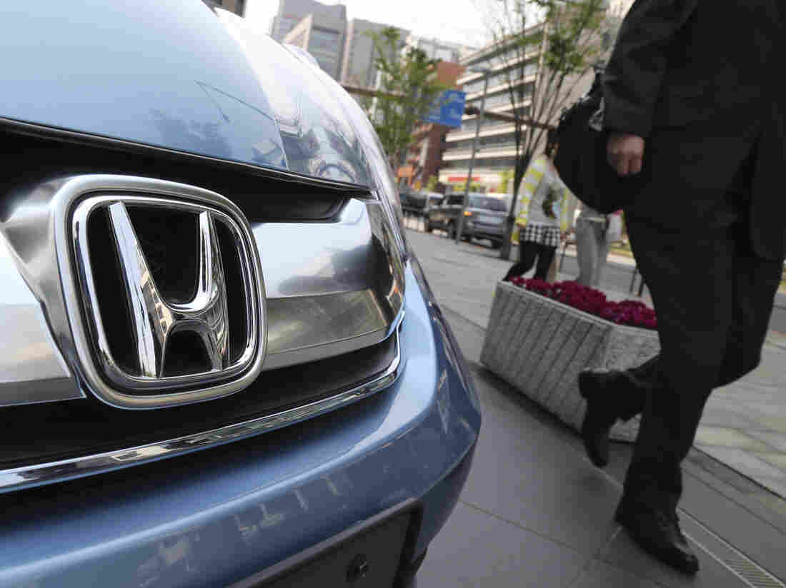 A man walks past a Honda on display at Honda Motor Co. headquarters in Tokyo. The Obama administration on Thursday, said it will fine Honda $70 million — the largest civil penalty leveled against an automaker --- for not reporting to regulators over 1,700 complaints that its vehicles caused deaths and injuries and not reporting warranty claims.