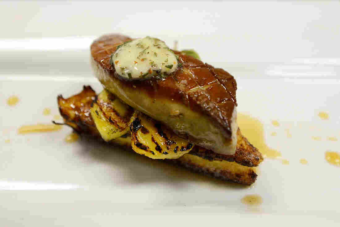 """A foie gras dish is prepared at Hot's Kitchen during a """"Farewell Fois Gras"""" event in June 2012 in Hermosa Beach, Calif. The restaurant was one of three plaintiffs that filed suit after the ban went into effect, and it has been serving free foie gras to guests ever since."""