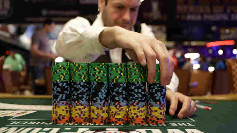 Dealer Omar Abu-Eid adjusts a stack of chips before the first day of the World Series of