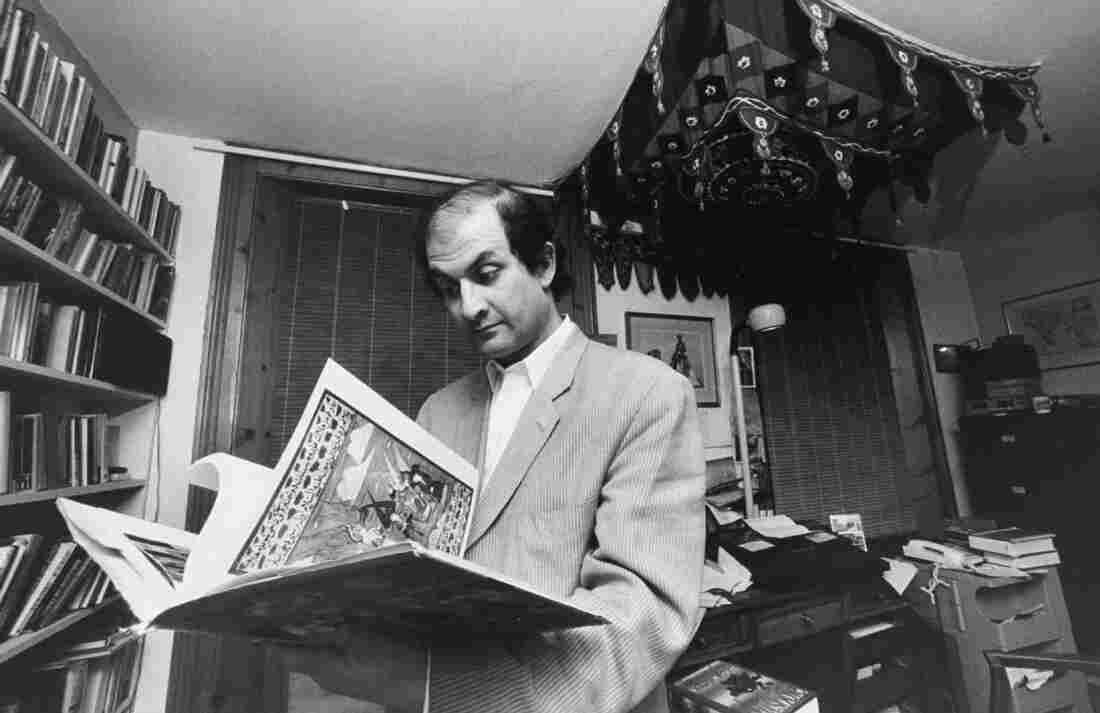 British writer Salman Rushdie leafs through a book in his study. He went into hiding for years after the Iranian leader Ayatollah Khomeini issued a fatwa calling for his death in 1989. The ayatollah denounced Rushdie's portrayal of the Prophet Muhammad in the novel The Satanic Verses.