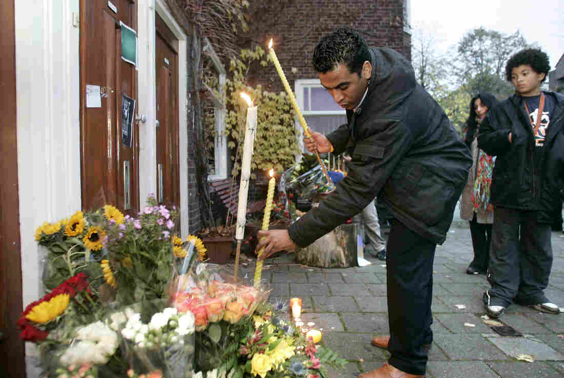A man places flowers at the home of slain Dutch filmmaker Theo van Gogh in 2004. Van Gogh was killed by a Muslim radical after he made a film criticizing the treatment of women in Islam.