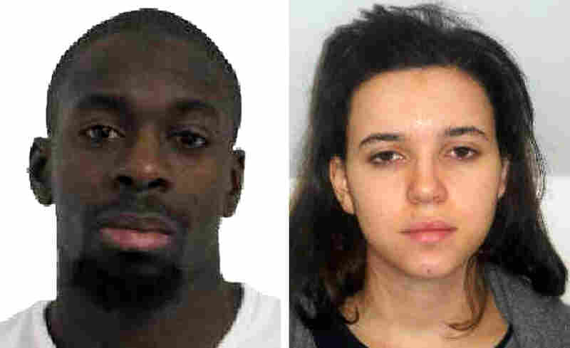 Amedy Coulibaly, seen in a police handout photo, was killed during a hostage situation at a kosher grocery in Paris on Friday. The whereabouts of Hayat Boumeddiene, at right, are unknown. French officials say she was involved in the killing of a policewoman in Paris on Thursday and possibly involved in the standoff at the market.