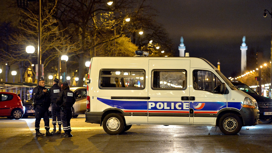 Police officers look for an escaped suspect Jan. 9 in Porte de Vincennes in Paris, France. Hayat Boumeddiene, 26, escaped and is wanted in connection with the murder of a policewoman. (Aurelien Meunier/Getty Images)