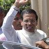 Sri Lanka's incoming President Maithripala Sirisena waves to supporters as he leaves the election secretariat in Colombo, Sri Lanka on Friday. Sirisena defeated long-time President Mahinda Rajapaksa.