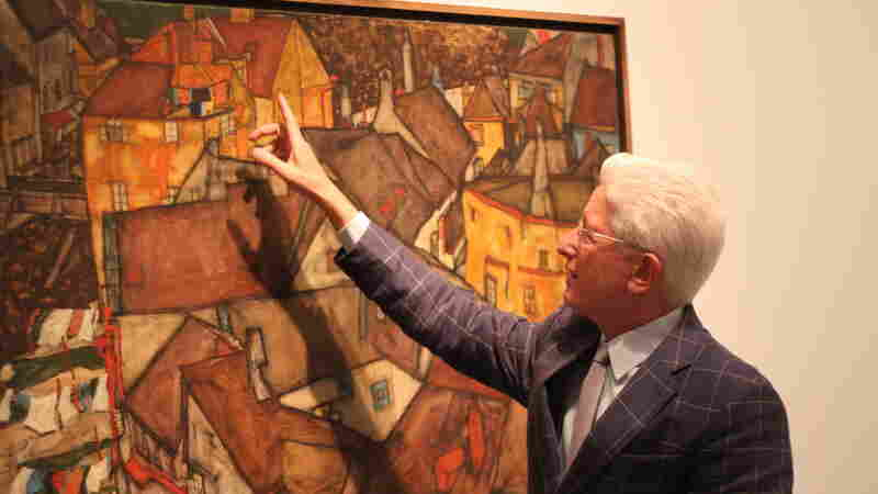 James Snyder, director of the Israel Museum in Jerusalem, with Egon Schiele's 1915 work, Krumau Town Crescent I. It's one of about 1,000 works of Nazi-confiscated art the museum has received. The museum has no record of who owned the painting before it was taken by the Nazis. In some 40 cases, the museum has returned artworks when heirs were found.