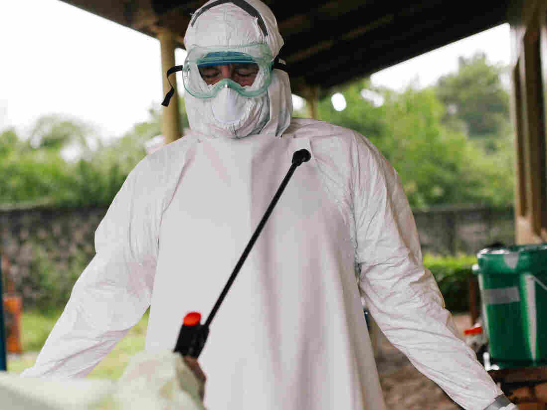 Dr. John Fankhauser, one of the many missionaries battling Ebola, is sprayed with disinfectant at ELWA hospital in Liberia.