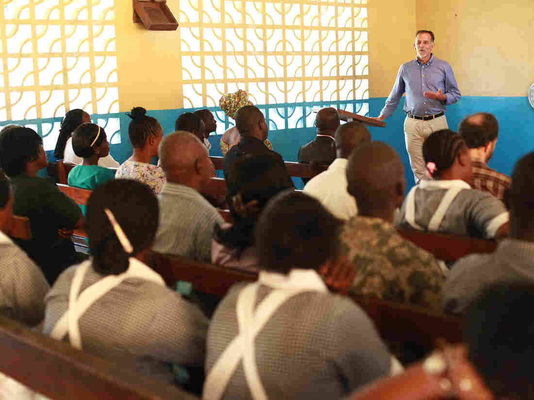 Dr. Fankhauser addresses worshippers at a service in Monrovia.