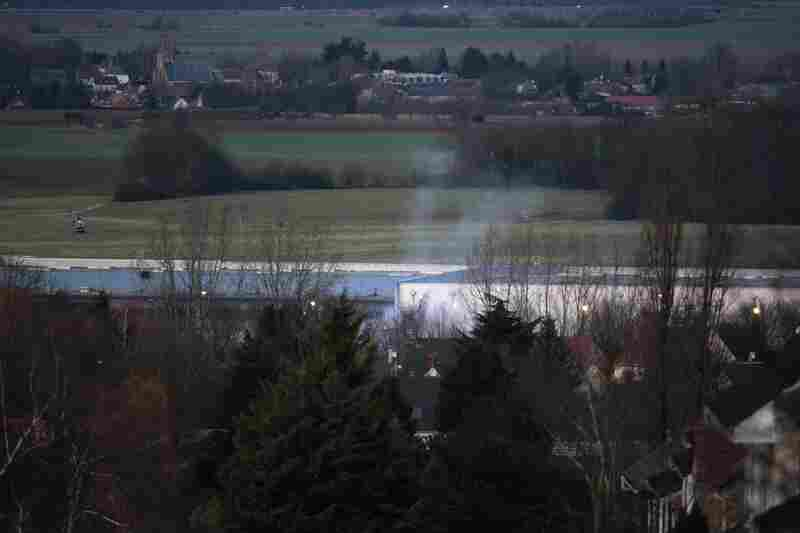 Smoke rises from a building in Dammartin-en-Goele, northeast of Paris, where two brothers suspected in the attack on the offices of Charlie Hebdo were cornered by police. The suspects, Said and Chérif Kouachi, were killed.