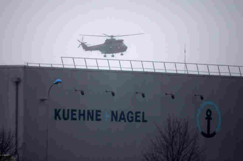 A military helicopter flies over Dammartin-en-Goele. The dramatic police standoffs in two areas outside Paris lasted for hours on Friday.