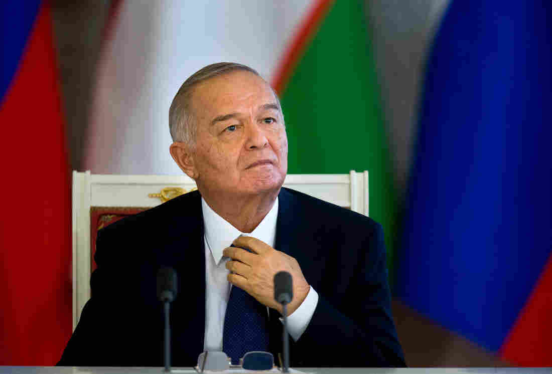 Uzbek President Islam Karimov looks on as Russian President Vladimir Putin, unseen, speaks to the media after talks in Moscow in April 2013.