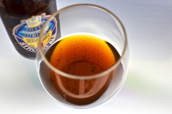 Sediment in a glass of 1977 Ind Coope Strong Ale. Proteins in very old beers can coagulate into chunks at the bottom of the bottle, Patrick Dawson explains in Vintage Beer.