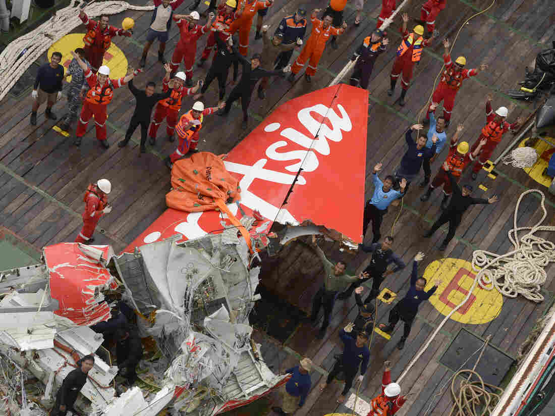 A large section of the AirAsia Flight 8501 tail was recovered from the sea floor and placed on the deck of a rescue ship in the Java Sea on Saturday.