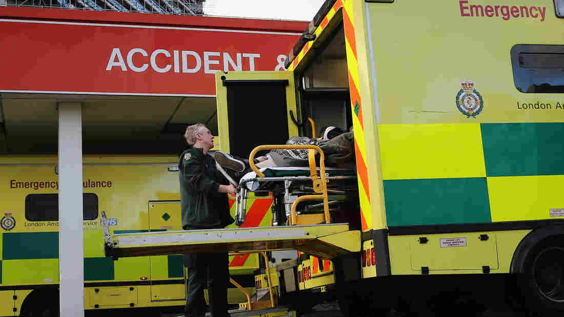 Emergency workers transport a patient to the Accident and Emergency ward at St. Thomas' Hospital in London. Recently released figures suggest the NHS in England has missed its four-hour A&E waiting time target, with performance dropping to its lowest level for a decade.
