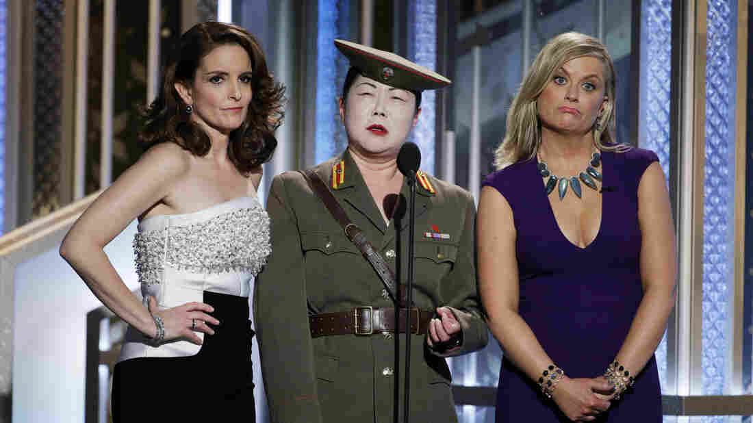 Tina Fey, Margaret Cho and Amy Poehler talk onstage during the 72nd Annual Golden Globe Awards. Fey and Poehler hosted the awards for the third (and, they say, final) time.