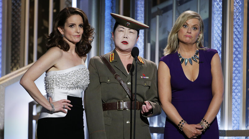 Tina Fey, Margaret Cho and Amy Poehler onstage during the 72nd Annual Golden Globe Awards. Fey and Poehler hosted the awards for the third (and, they say, final) time.