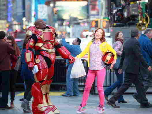 Actors Tituss Burgess and Ellie Kemper horse around on the set of The Unbreakable Kimmy Schmidt while filming in New York in March. Tina Fey's new TV series was developed for NBC, but will air on Netflix instead.