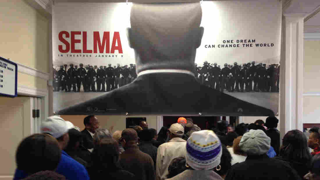 Selma residents, many with firsthand connections to the city's civil rights movement, file into the Walton Theater for a free screening of Selma.