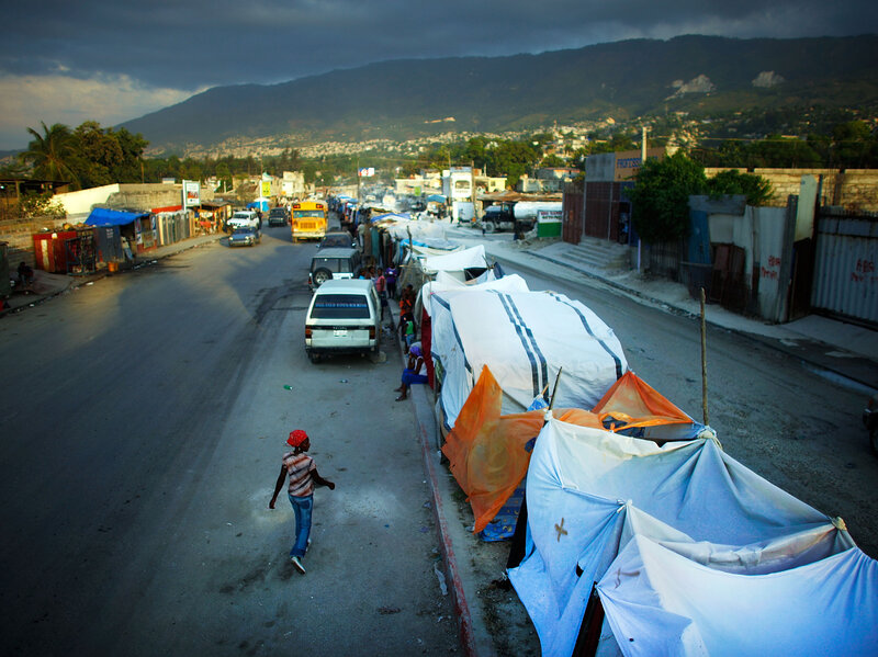 After the earthquake in 2010, about a thousand people were living in tents on the median of Highway 2, one of Haiti's busiest roads. Five years later, tens of thousands of people in Port-au-Prince still live in tents and other temporary housing.
