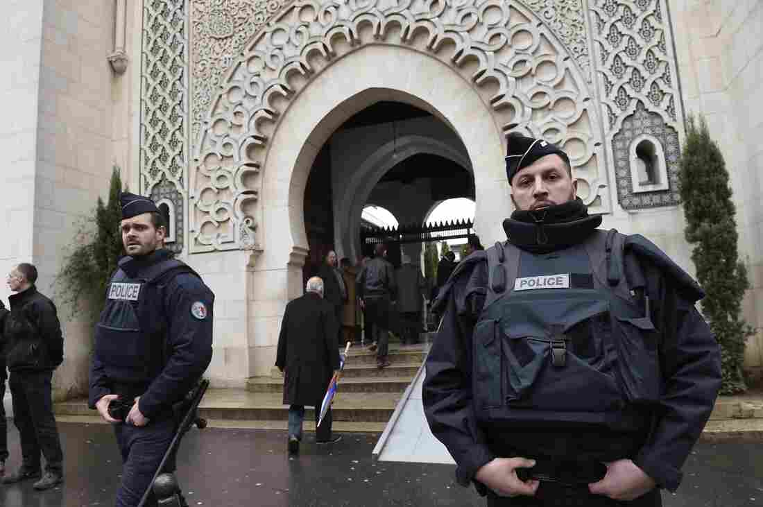 French police officers stand guard outside Paris' Grand Mosque on Friday as a hostage-taking crisis unfolded at a kosher supermarket. Nonetheless, the mosque's Grand Mufti says there are no plans to add any additional security of its own.