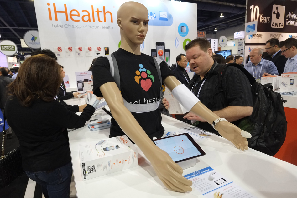 Visitors check out wireless blood pressure monitors at the Consumer Electronics Show in Los Angeles. (Joe Klamar/AFP/Getty Images)