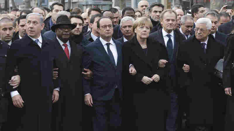 """World leaders, including, from the left, Israel's Prime Minister Benjamin Netanyahu, Mali's Ibrahim Boubacar Keita, France's Francois Hollande, Germany's Angela Merkel, EU President Donald Tusk and Palestinian President Mahmoud Abbas march in Paris on Sunday to honor the victims of three days of bloodshed. A White House spokesman acknowledged """"we should have sent someone with a higher profile."""""""