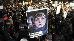 Organizers Of Anti-'Islamization' Rally In Germany Mark Paris Attack