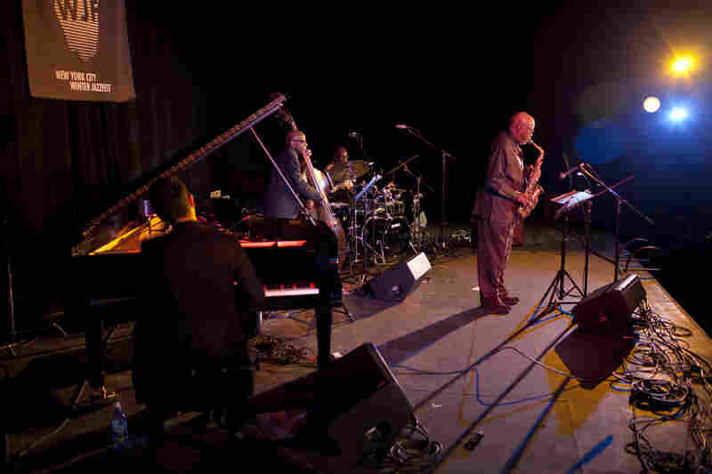 The elder statesmen of Trio 3 — Oliver Lake (saxophone), Reggie Workman (bass) and Andrew Cyrille (drums) — invited pianist Vijay Iyer to join them on stage, much as he did on the band's 2014 album Wiring.