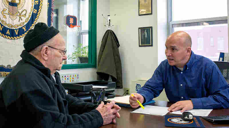 Grant County Veterans Service Officer Bob Kelley (right) works with World War II Army veteran Frederick Kern at the Grant County Government Building in Marion, Ind., on Monday.