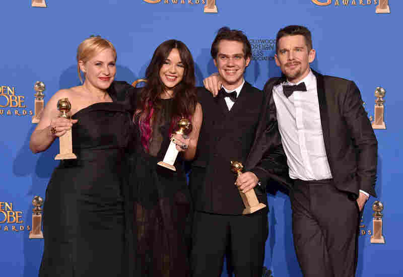 The cast of Boyhood — (from left) Patricia Arquette, Lorelei Linklater, Ellar Coltrane and Ethan Hawke — won the Golden Globe for best motion picture on Sunday.