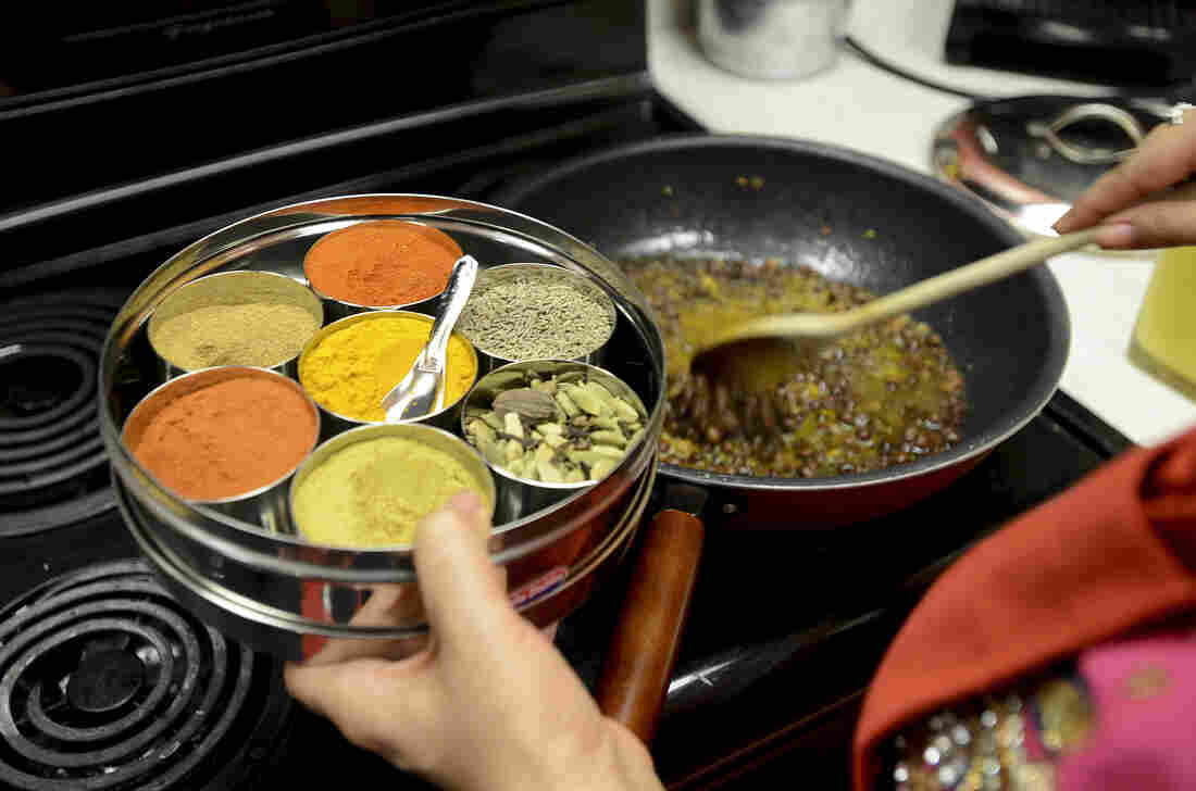 Jasjit Kaur Singh, an Indian chef, cooks kaala channa, a traditional spicy Sikh dish. A psychologist says that children who grow up in cultures with lots of spicy food are taught to like spice early on.
