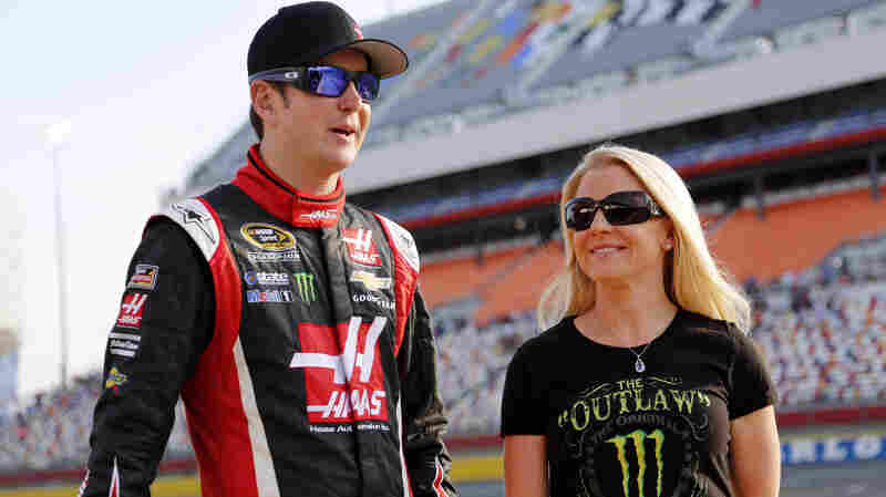In this May 22, 2014, photo, Kurt Busch walks with Patricia Driscoll before a race at Charlotte Motor Speedway in Concord, N.C. The former couple has been in court over Driscoll's claim that Busch assaulted her.