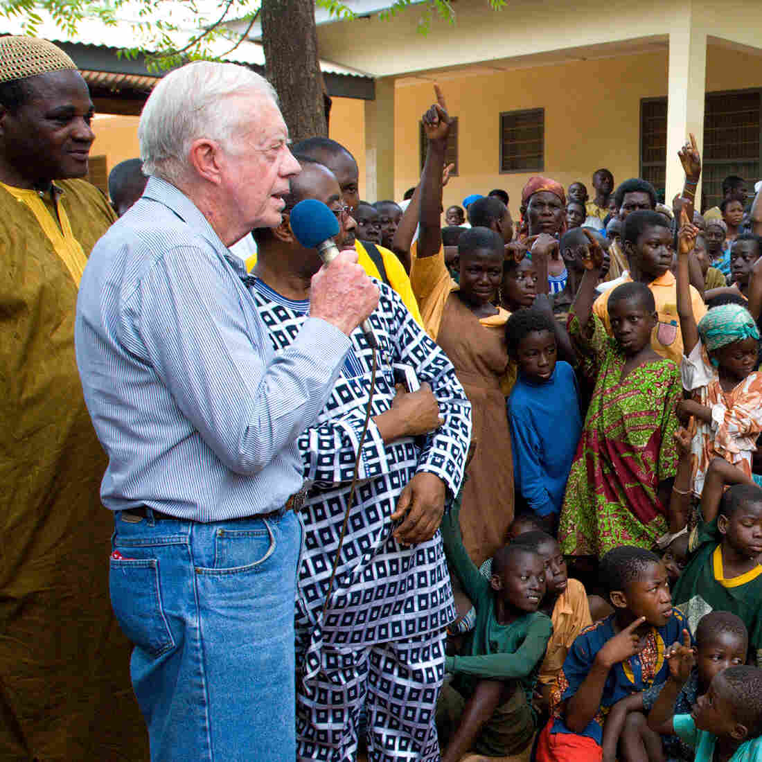 On a 2007 visit to Savelugu Hospital in Ghana, President Jimmy Carter asks a group of children if they've had Guinea worm. A raised hand is a yes.