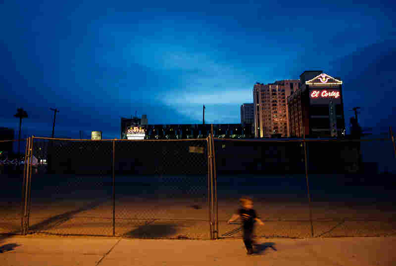A child runs past an empty lot en route to evening events at the Container Park.