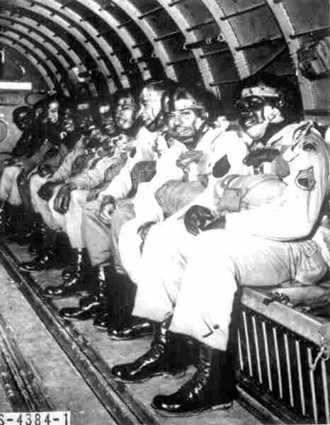 Black soldiers ride in a C-47 transport plane preparing to make a qualifying jump in March 1944.
