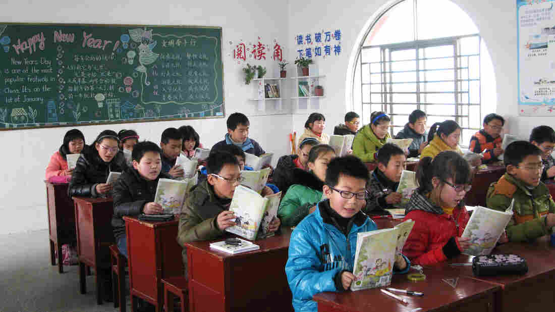 A  number of the students at the Yangkou Township Elementary School face difficulties at home, where many of them are being raised by grandparents after their parents have gone to the cities seeking work.