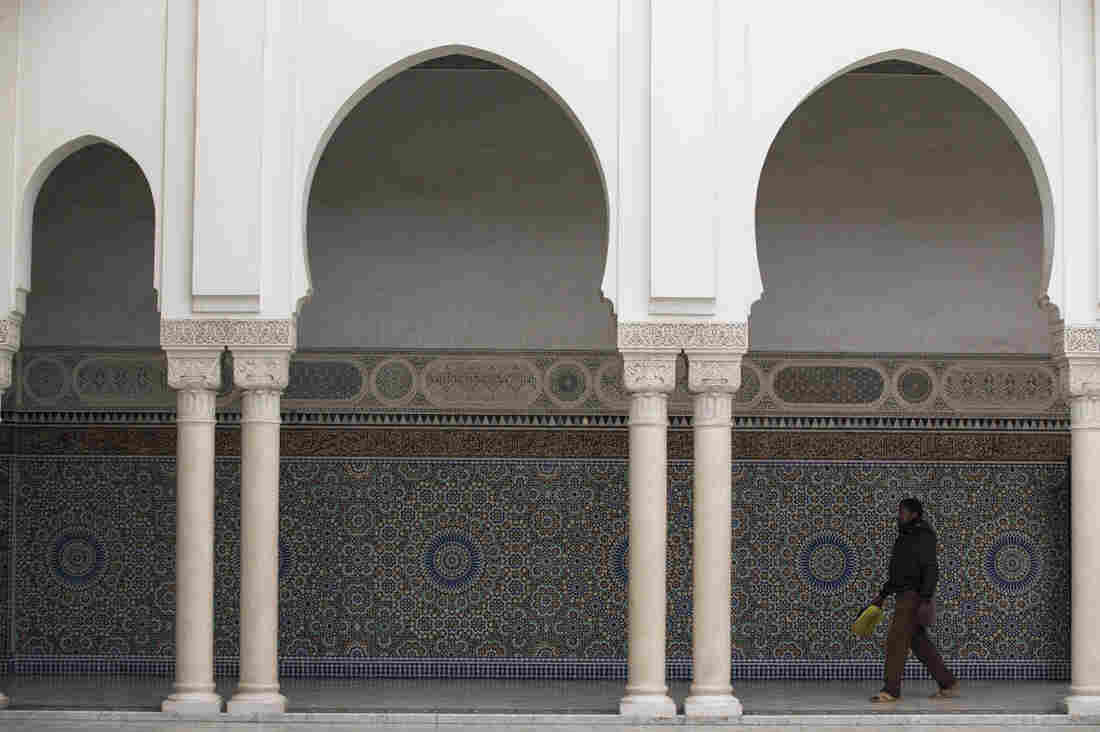 A man walks through the Grand Mosque in Paris on Jan. 9. Some Muslims have questioned the official version of the shootings in Paris and embraced conspiracy theories. In schools, some Muslim students refused to take part in a moment of silence for the victims.