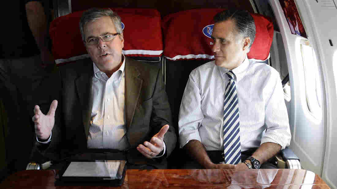 Former Massachusetts Gov. Mitt Romney (right) talks with former Florida Gov. Jeb Bush on Romney's campaign plane in 2012.